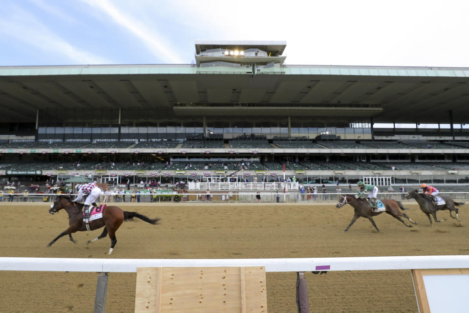 Tiz the Law (8), with jockey Manny Franco up, crosses the finish line ahead of Dr Post (9), with jockey Irad Ortiz Jr. up, and Max Player (3), with jockey Joel Rosario up, in front of an empty grandstand to win the152nd running of the Belmont Stakes horse race, Saturday, June 20, 2020, in Elmont, N.Y. (AP Photo/Seth Wenig)