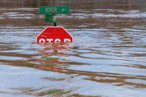PHOTO: A road sign is submerged in water after flooding from heavy rains, March 1, 2021, in Beattyville, Ky. (Courier Journal via USA Today Network)