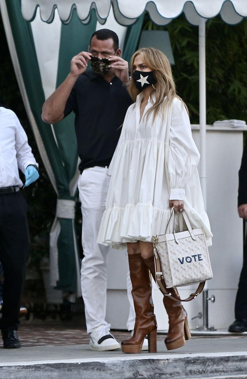 """<p>To catch dinner with her beau A Rod, J Lo stepped out in the perfect date night outfit, consisting of knee-high platform boots, an oversized shirt mini dress, a star mask, and a Coach bag with the encouragement 'VOTE' on its side. </p><p>Over the weekend the loved-up pair dressed up for <a href=""""https://www.elle.com/uk/fashion/trends/g16320/celebrity-halloween-costumes/"""" rel=""""nofollow noopener"""" target=""""_blank"""" data-ylk=""""slk:Halloween"""" class=""""link rapid-noclick-resp"""">Halloween</a>, with Lopez as Queen of Pop Madonna, and Rodriguez as Bruce Springsteen.</p><p><a class=""""link rapid-noclick-resp"""" href=""""https://go.redirectingat.com?id=127X1599956&url=https%3A%2F%2Fwww.selfridges.com%2FGB%2Fen%2Fcat%2Fcoach-tabby-pebbled-leather-shoulder-bag_1045-3005401-73995B4HA%2F&sref=https%3A%2F%2Fwww.elle.com%2Fuk%2Ffashion%2Fcelebrity-style%2Fg28491328%2Fjennifer-lopez-best-looks%2F"""" rel=""""nofollow noopener"""" target=""""_blank"""" data-ylk=""""slk:SHOP COACH BAG"""">SHOP COACH BAG</a></p>"""