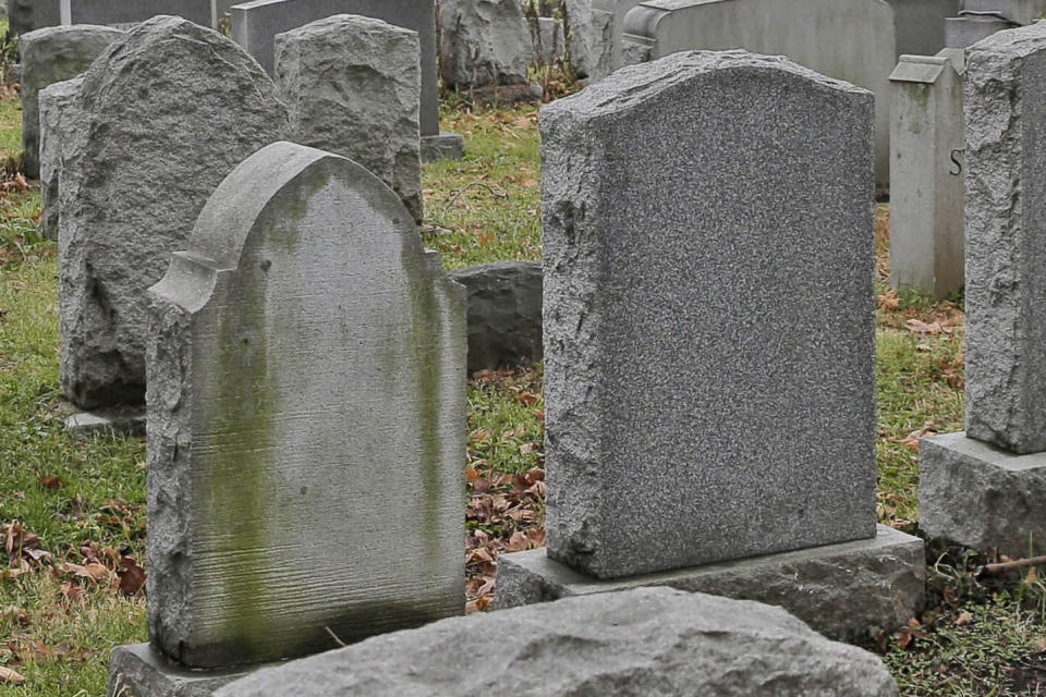 FILE - This Dec. 11, 2019 file photo shows gravestones at a cemetery in New Jersey. The U.S. suicide death rate fell slightly in 2019, the first annual decline in more than a decade, according to new government data. (AP Photo/Seth Wenig)