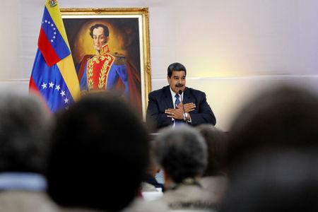 Venezuela's President Nicolas Maduro great the International observers for the upcoming May 20 election at the presidential palace in Caracas