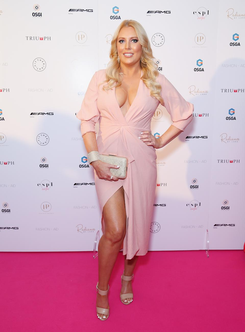 Mel Greig wears a pink dress on the red carpet at the FASHION + AID 2018 Sydney on November 24, 2018 in Sydney, Australia