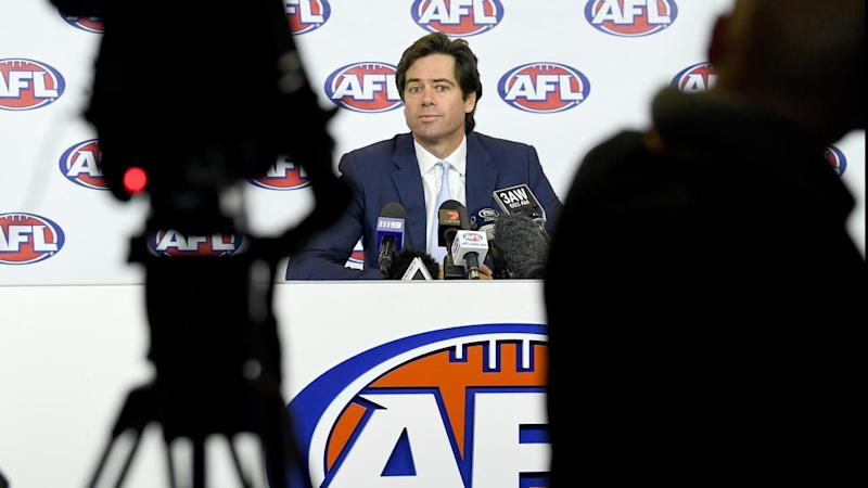 AFL chief Gillon McLachlan announces the resignations of Simon Lethlean and Richard Simkiss