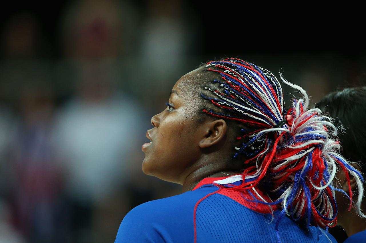 LONDON, ENGLAND - JULY 28: Isabelle Yacoubou #4 of France looks on during the national anthem before playing against Brazil during Women's Basketball on Day 1 of the London 2012 Olympic Games at the Basketball Arena on July 28, 2012 in London, England.  (Photo by Christian Petersen/Getty Images)