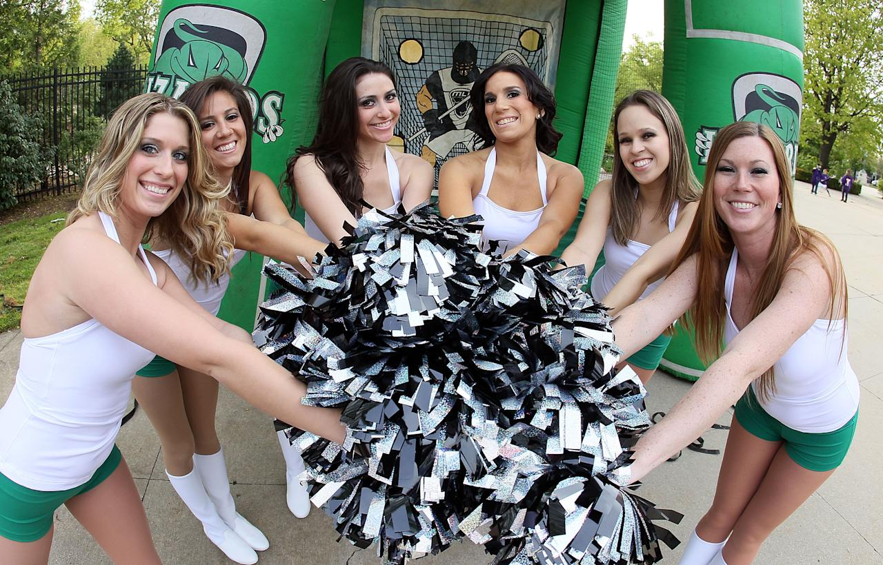 UNIONDALE, NY - APRIL 28:  The Long Island Lizards cheerleaders pose for a photograph before the game against the Chesapeake Bayhawks on April 28, 2012 at Shuart Stadium in Uniondale, New York.  (Photo by Jim McIsaac/Getty Images)