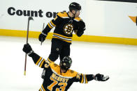 Boston Bruins left wing Taylor Hall (above) celebrates his winning goal with defenseman Charlie McAvoy (73) in the overtime period of an NHL hockey game against the New York Islanders, Monday, May 10, 2021, in Boston. (AP Photo/Elise Amendola)