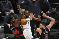 Brooklyn Nets forward Kevin Durant (7) passes the ball away from Chicago Bulls forward Patrick Williams (44) and center Nikola Vucevic (9) during the second half of an NBA basketball game Tuesday, May 11, 2021, in Chicago. (AP Photo/Matt Marton)