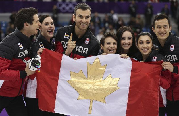 Team Canada celebrates their gold medal win in the figure skating team event at the PyeongChang Olympics on Feb. 11, 2018.