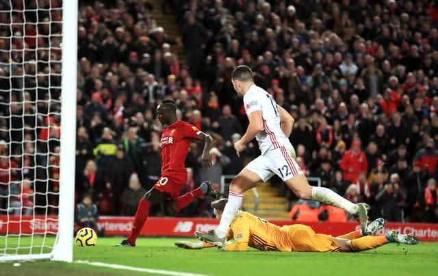 Liverpool's Sadio Mane scores his side's second goal (Peter Byrne/PA)