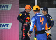 First place for pole position, Red Bull driver Max Verstappen of the Netherlands, left, speaks with third place, Red Bull driver Sergio Perez of Mexico, right, after the qualifying session ahead of the Austrian Formula One Grand Prix at the Red Bull Ring racetrack in Spielberg, Austria, Saturday, July 3, 2021. The Austrian Grand Prix will be held on Sunday. (Christian Bruna/Pool Photo via AP)
