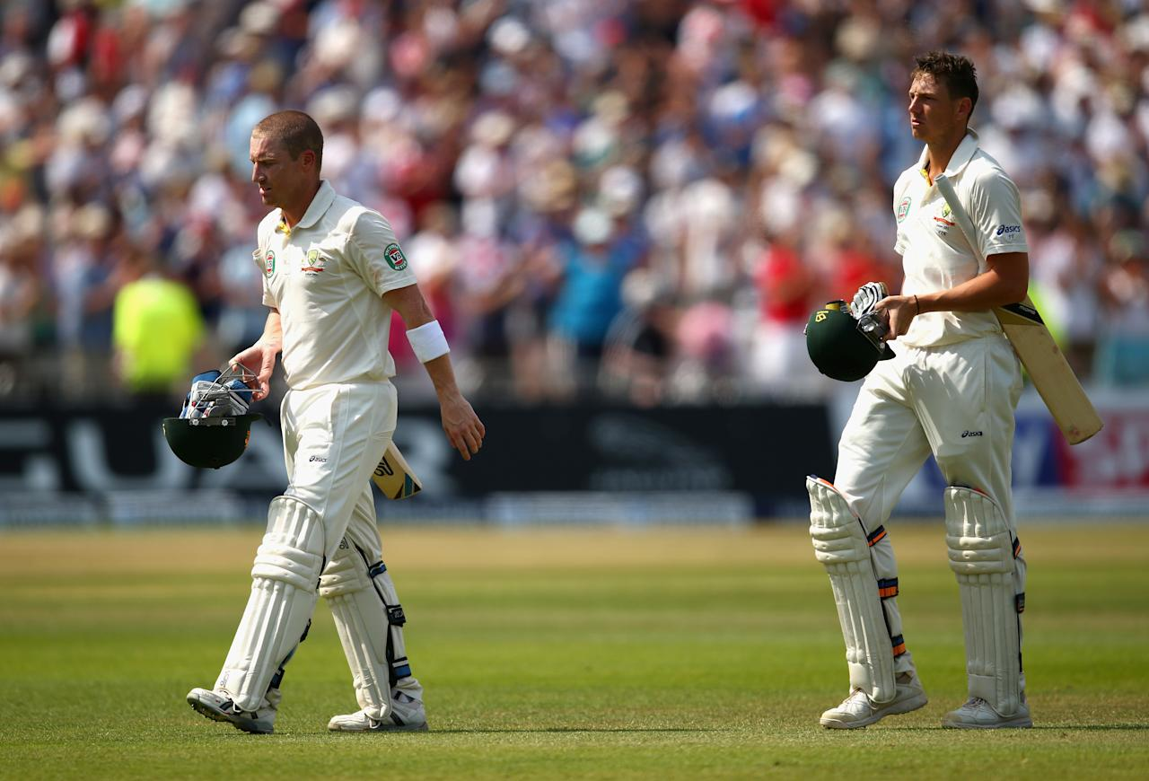 NOTTINGHAM, ENGLAND - JULY 14:  Brad Haddin and James Pattinson of Australia look dejected after James Anderson of England took the final wicket to claim victory during day five of the 1st Investec Ashes Test match between England and Australia at Trent Bridge Cricket Ground on July 14, 2013 in Nottingham, England.  (Photo by Ryan Pierse/Getty Images)