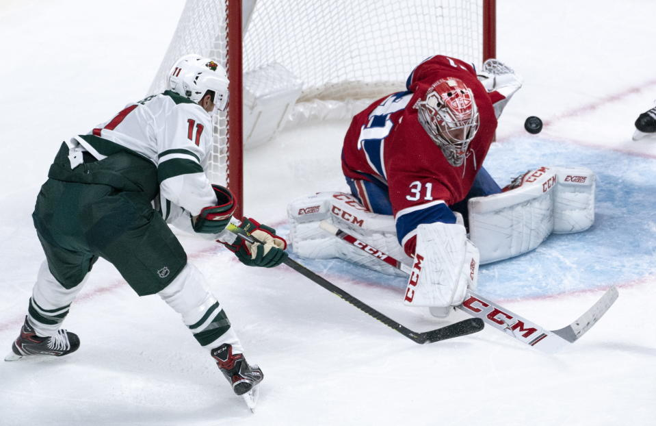 Montreal Canadiens goaltender Carey Price deflects a shot by Minnesota Wild's Zach Parise wide of his net during second-period NHL hockey game action in Montreal, Thursday, Oct. 17, 2019. (Paul Chiasson/The Canadian Press via AP)
