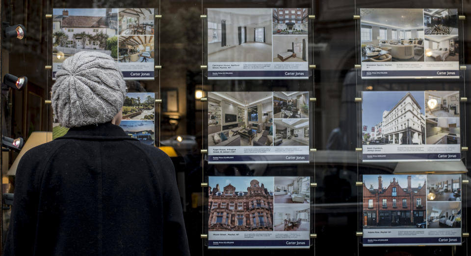 File photo dated 22/3/2017 of a woman looking in the window of an estate agents. Liverpool, Aberdeen, Cardiff and Nottingham are among the best locations for single house hunters to buy a property, analysis suggests.