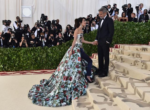 Amal Clooney and George Clooney arrive at the 2018 Met Gala on May 7, 2018 in New York. (Photo: HECTOR RETAMAL/AFP/Getty Images)