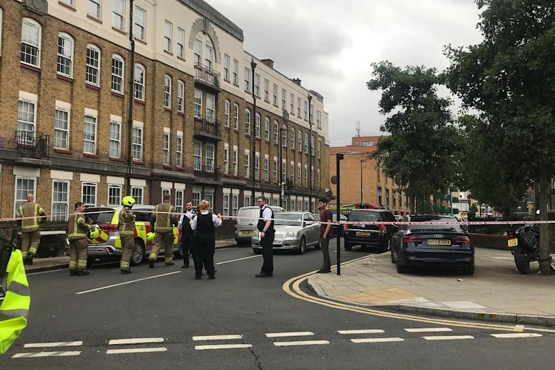 Firefighters and police officers at the scene in Bow, east London (Rachael Burford)