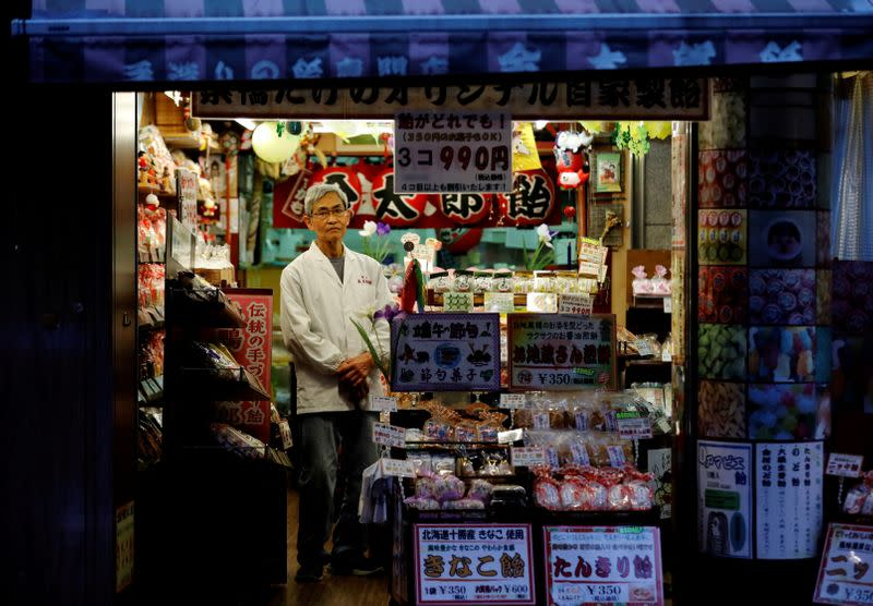 FILE PHOTO: The Wider Image: From the streets of Tokyo, 22 residents weigh up the Olympic Games