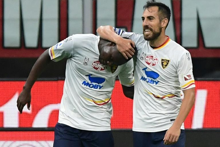 Senegalese forward Khouma Babacar (L) is congratulated by Lecce teammate Marco Mancosu after scoring in a 2-2 Serie A draw at AC Milan (AFP Photo/Miguel MEDINA)