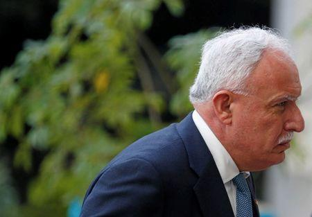 FILE PHOTO: Palestinian Foreign Minister Riyad al-Maliki arrives to attend a meeting with Arab counterparts on the situation in Jerusalem, in Cairo