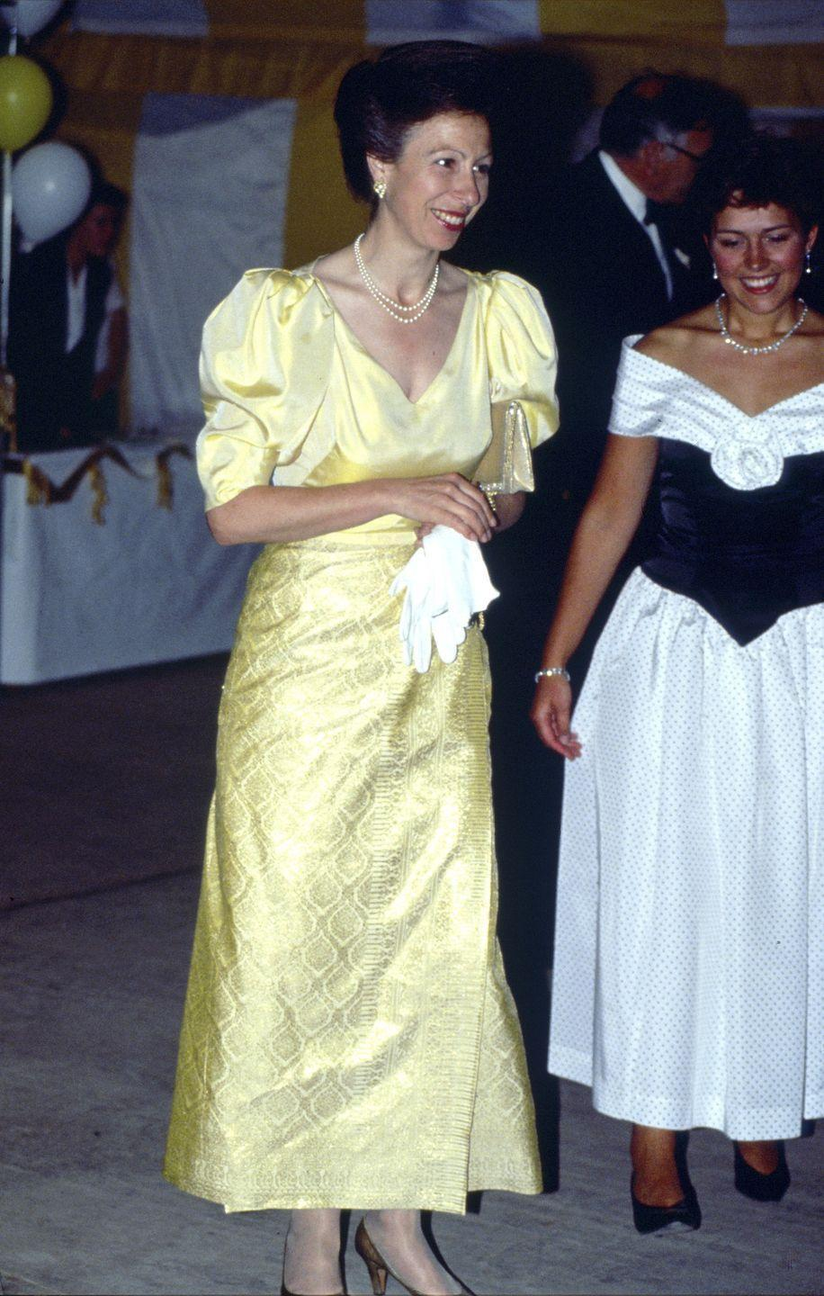 <p>Princess Anne wore a silk evening gown in 1992 to the Young Farmers Golden Jubilee Ball, which reminds us of Belle's gown for its pale yellow hue and puffy sleeves. </p>