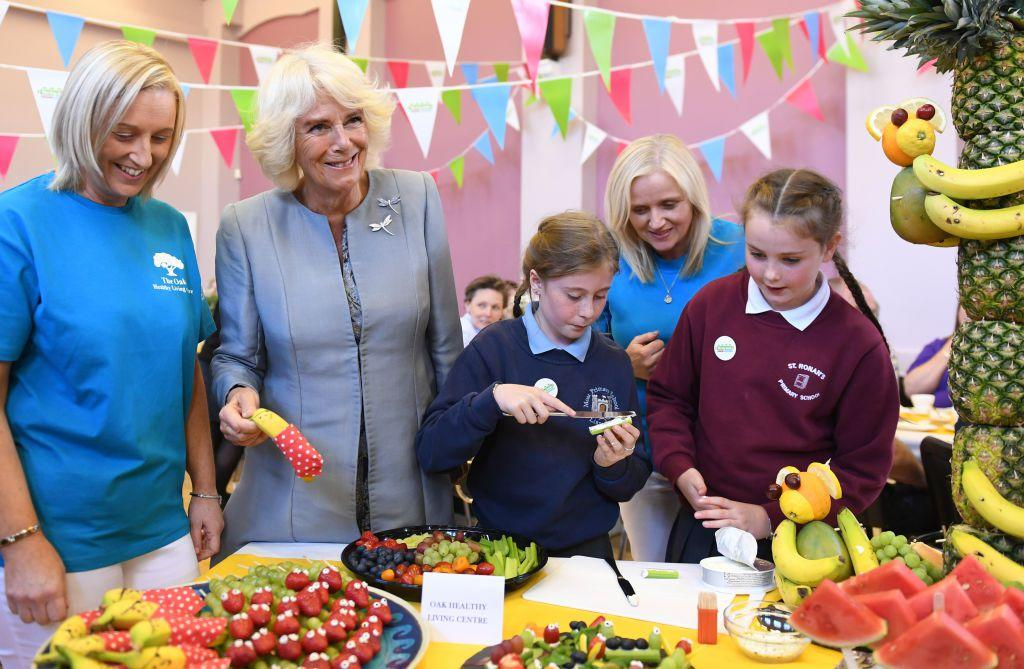 <p>The Duchess of Cornwall helps school children prepare food during a community event entitled A Celebration of Community in Lisnaskea in County Fermanagh.</p>