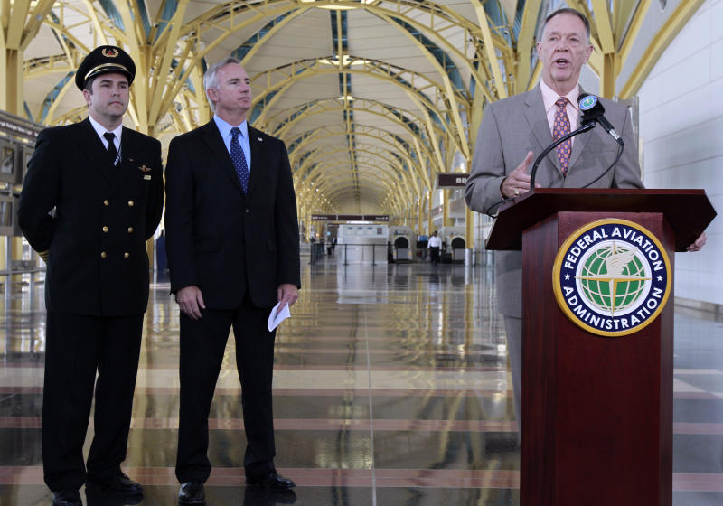 FAA Administrator Randy Babbitt, right, accompanied by Air Line Pilots Association International President Lee Moak, center, and Delta Airlines pilot Chad Smith, talks about the civil penalties for pointing a laser into a plane cockpit, Wednesday, June 1, 2011, at Washington's Ronald Reagan National Airport. (AP Photo/Alex Brandon)