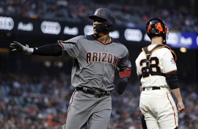 Arizona Diamondbacks' Ketel Marte, left, scores on a triple from Paul Goldschmidt during the first inning of a baseball game against the San Francisco Giants, Monday, April 9, 2018, in San Francisco. (AP Photo/Marcio Jose Sanchez)