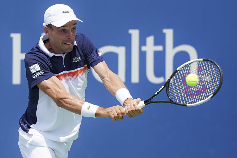 Roberto Bautista Agut, of Spain, returns to Richard Gasquet, of France, during the Western & Southern Open tennis tournament, Friday, Aug. 16, 2019, in Mason, Ohio. (AP Photo/John Minchillo)