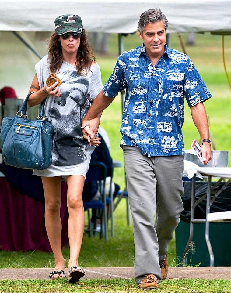 "A number of media outlets reported that George Clooney and his girlfriend Elisabetta Canalis had split up. According to the website Hollyscoop, Clooney ""called off his 9-month relationship right after their Oscar appearance in March ... because of Elisabetta's partying ways."" So did Clooney really part with his girlfriend because of her partying? See what Clooney himself told <a href=""http://www.gossipcop.com/george-clooney-elisabetta-canalis-split-broke-up-rumor/"" target=""new"">Gossip Cop</a>. Hypnotics/starsurf/<a href=""http://www.splashnewsonline.com"" target=""new"">Splash News</a> - April 8, 2010"