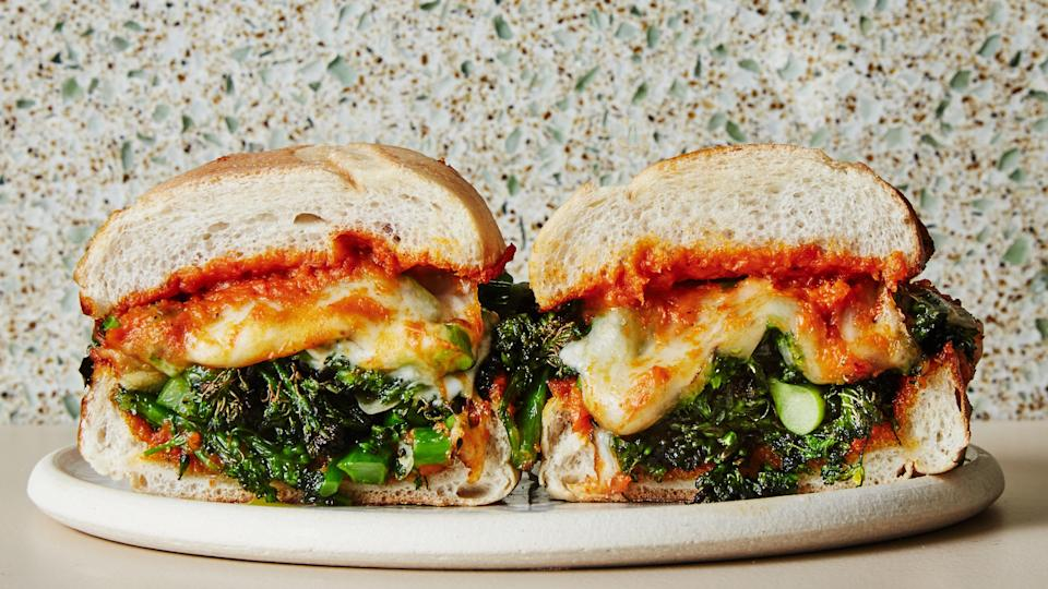 "A healthyish take on the classic Philly cheesesteak, these party-ready sandwiches are packed with roasted broccolini, a thick, tangy romesco sauce, and of course, lots of cheese. You've heard it before, and you may not believe us until you've tried them, but you won't miss the meat. This recipe was developed by <a href=""http://www.roostersoupcompany.com/"" rel=""nofollow noopener"" target=""_blank"" data-ylk=""slk:Rooster Soup Co."" class=""link rapid-noclick-resp"">Rooster Soup Co.</a> in Philadelphia, PA. <a href=""https://www.bonappetit.com/recipe/broccolini-cheesesteaks?mbid=synd_yahoo_rss"" rel=""nofollow noopener"" target=""_blank"" data-ylk=""slk:See recipe."" class=""link rapid-noclick-resp"">See recipe.</a>"