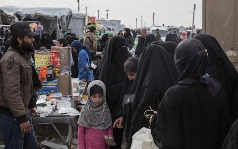 Residents of a camp for people who lived under ISIS and are now displaced shop at a market area of a camp run by Kurdish authorities in Al Hol - Credit: Sam Tarling/The Telegraph