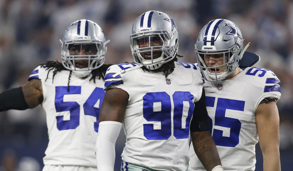 Dallas Cowboys defensive end Demarcus Lawrence (90) and outside linebacker Leighton Vander Esch (55)