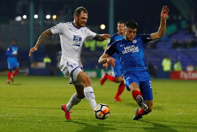 Soccer Football - FA Cup First Round Replay - Tranmere Rovers vs Peterborough United - Prenton Park, Birkenhead, Britain - November 15, 2017 Tranmere Rovers' James Norwood in action with Peterborough United's Jack Baldwin Action Images/Jason Cairnduff