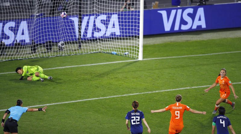 Netherlands' Lieke Martens, right, reacts after scoring from the penalty spot during the Women's World Cup round of 16 soccer match between the Netherlands and Japan at Roazhon Park, in Rennes, France, Tuesday, June 25, 2019. (AP Photo/Francois Mori)