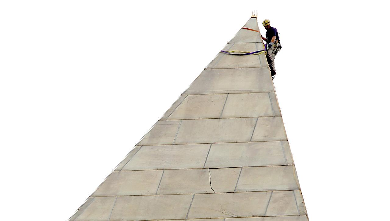 WASHINGTON, DC - SEPTEMBER 27: An engineer begins the process of conducting a block-by-block inspection of the exterior of the Washington Monument while suspended by ropes September 27, 2011 in Washington, DC. The National Park Service has closed the landmark in the nation's capital indefinitely due to damage caused by a 5.8 magnitude earthquake in August. (Photo by Win McNamee/Getty Images)