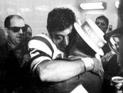 FILE - In this Jan. 12, 1969, file photo, New York Jets quarterback Joe Namath gives his father, who is wearing an Orange Bowl hat, a big hug in the Jets' locker room after leading the team to a 16-7 win over Baltimore Colts in the Super Bowl III NFL football game in Miami. (AP Photo/File)