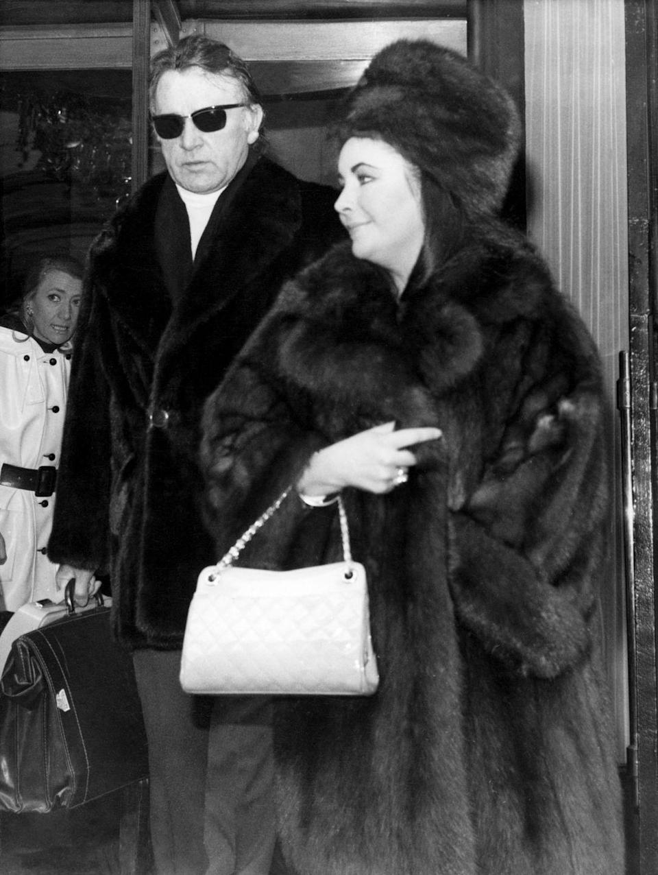 <p>Elizabeth Taylor and Richard Burton (i.e. Liz and Dick) were spotted leaving their hotel in Paris, but her quilted bag really stole the show. The pattern was widely popular and seen on practically every purse. </p>