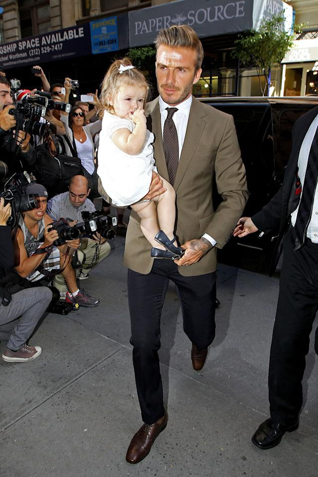 """<p class=""""MsoNormal"""">Earlier in the day, Harper snagged a front row seat alongside her dapper dad at her mom's show. This was the 14-month-old's third fashion week and the she was dressed to perfection in a white frock and navy Mary Janes. How adorable is she? (9/9/12)</p>"""