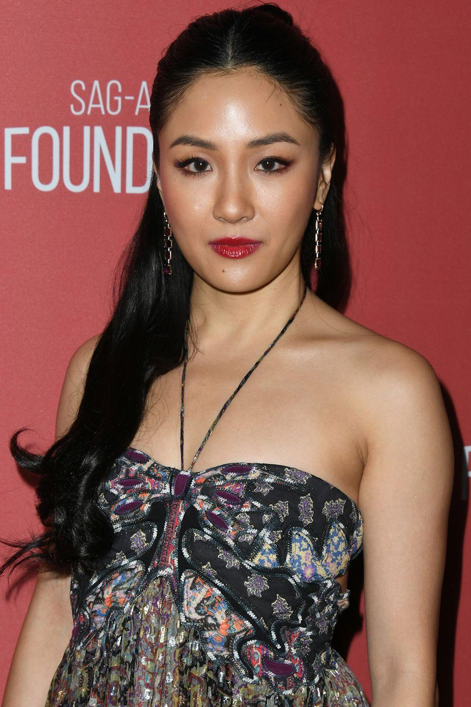 <p>If you're a fan of a middle part, wear your half-up hairstyle like Constance Wu.</p>