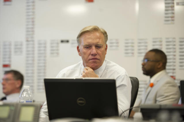In this photo provided by the Denver Broncos, Denver Broncos vice president John Elway monitors the NFL draft at the NFL football team's headquarters in Englewood, Colo., on Thursday, May 8, 2014. The Broncos are scheduled to pick 31st in the first round.(AP Photo/Denver Broncos, Eric Lars Bakke)