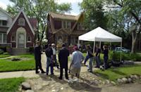 FILE - In this May 28, 2004, file photo, members of the media gather outside a Detroit home where investigators ripped up floorboards where one-time Jimmy Hoffa ally Frank Sheeran claims to have killed him. Hoffa's mysterious disappearance, assumed death and myriad searches for his body have been the stuff of urban legends for more than three decades. (AP Photo/Detroit News, Seth Lower) DETROIT FREE PRESS OUT; HUFFINGTON POST OUT