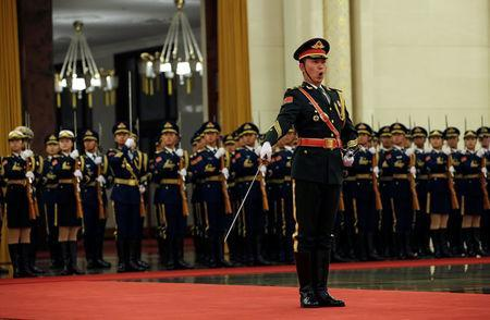 Members of the honour guards practice ahead of a welcoming ceremony for Israeli Prime Minister Benjamin Netanyahu at the Great Hall of the People in Beijing, China March 20, 2017. REUTERS/Jason Lee