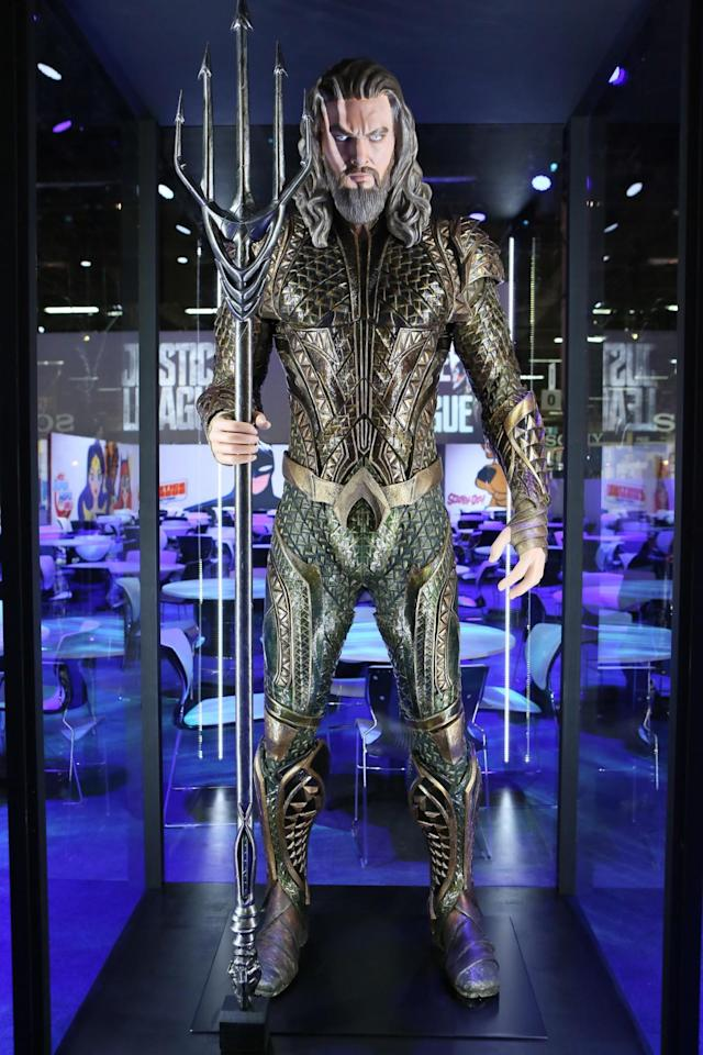 "<p>Our best look yet at the sea king's Atlantean armor featuring the iconic ""A"" belt buckle and the golden/green color scheme from the comics. Don't get on the business end of that trident, er, <em>quintdent</em>. (Credit: Warner Bros.) </p>"