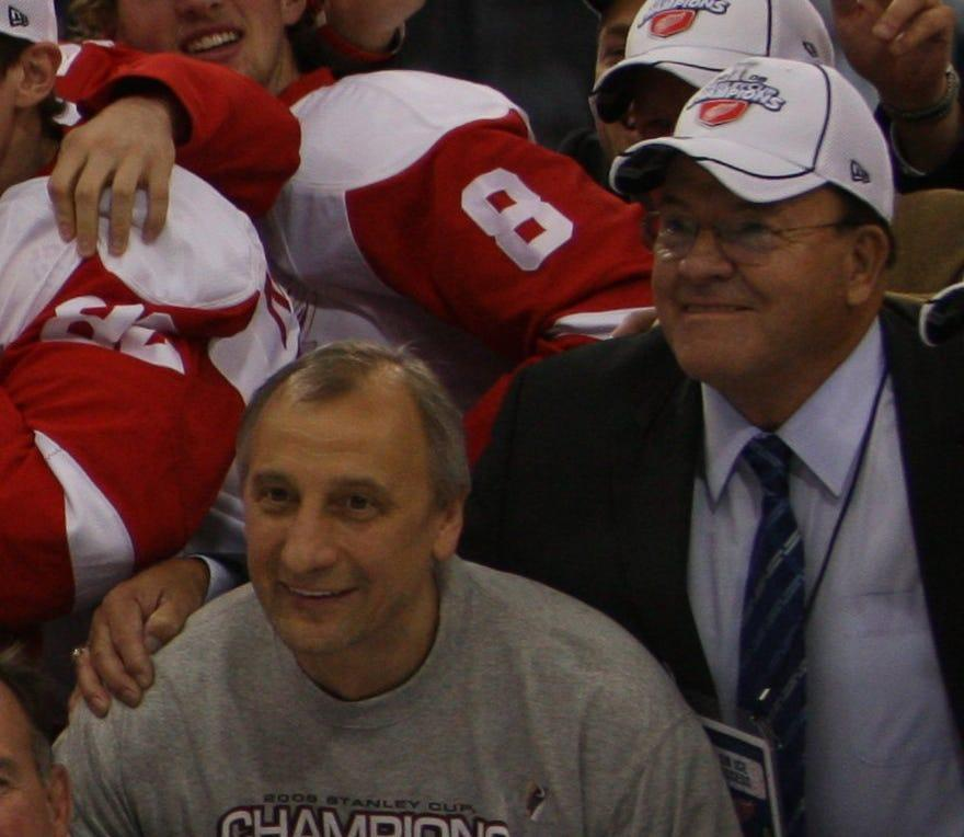 Longtime Red Wings trainer Sergei Tchekmarev, left, celebrates the team's 2008 Stanley Cup victory on the ice with former Wings coach Scotty Bowman on June 4, 2008.
