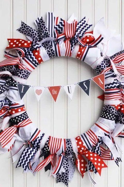 """<p>This rustic wreath covered in red, white, and blue ribbon can stay on your front door all summer long.</p><p><strong>Get the tutorial at <a href=""""http://www.landeeseelandeedo.com/2014/06/patriotic-ribbon-wreath.html"""" rel=""""nofollow noopener"""" target=""""_blank"""" data-ylk=""""slk:Landeelu"""" class=""""link rapid-noclick-resp"""">Landeelu</a>. </strong></p><p> <a class=""""link rapid-noclick-resp"""" href=""""https://www.amazon.com/Morex-Ribbon-6-Pack-Polyester-Patriotic/dp/B00C93KO2U/ref=sr_1_2?tag=syn-yahoo-20&ascsubtag=%5Bartid%7C10050.g.4464%5Bsrc%7Cyahoo-us"""" rel=""""nofollow noopener"""" target=""""_blank"""" data-ylk=""""slk:SHOP PATRIOTIC RIBBON"""">SHOP PATRIOTIC RIBBON</a></p>"""