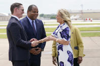 First lady Jill Biden is greeted by Dallas Mayor Eric Johnson, second from left, Rep. Eddie Bernice Johnson, D-Texas, obscured, and Dallas County Judge Clay Jenkins as she arrives at Love Field Airport in Dallas, Tuesday, June 29, 2021. (AP Photo/Carolyn Kaster, Pool)