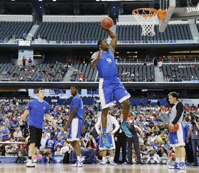 Kentucky forward Julius Randle dunks during practice for their NCAA Final Four tournament college basketball semifinal game Friday, April 4, 2014, in Dallas. Kentucky plays Wisconsin on Saturday, April 5, 2014. (AP Photo/Eric Gay)