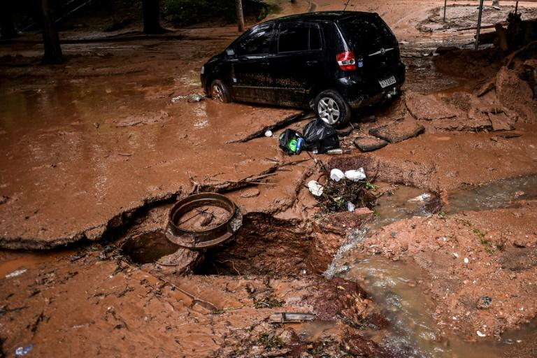 View of a car on January 29, 2020 that was dragged by heavy rains in Belo Horizonte, Brazil