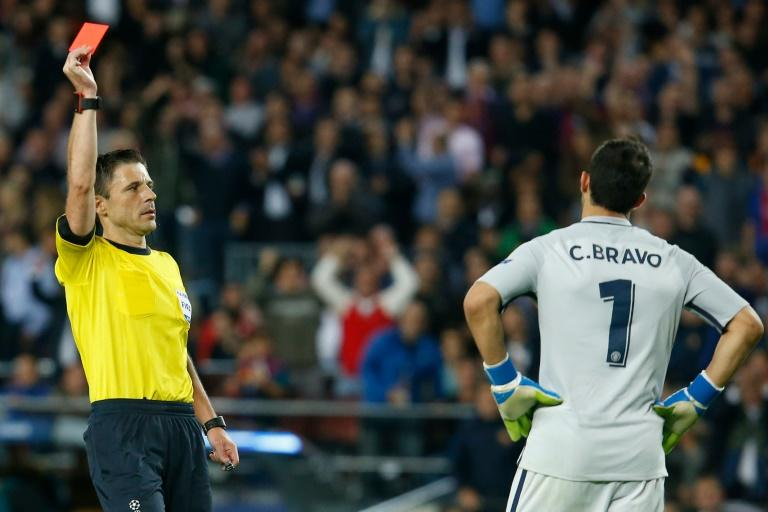 Referee shows red card to Manchester City's goalkeeper Claudio Bravo during the UEFA Champions League match FC Barcelona vs Man City, at the Camp Nou stadium in Barcelona, on October 19, 2016
