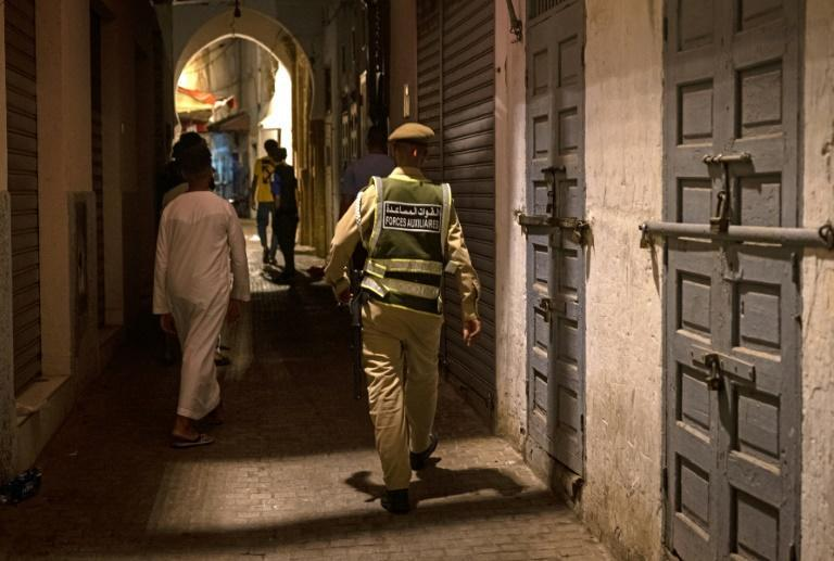 A new surge in Covid cases in early August prompted Moroccan authorities to impose a new curfew and restrictions on movement and gatherings (AFP/FADEL SENNA)