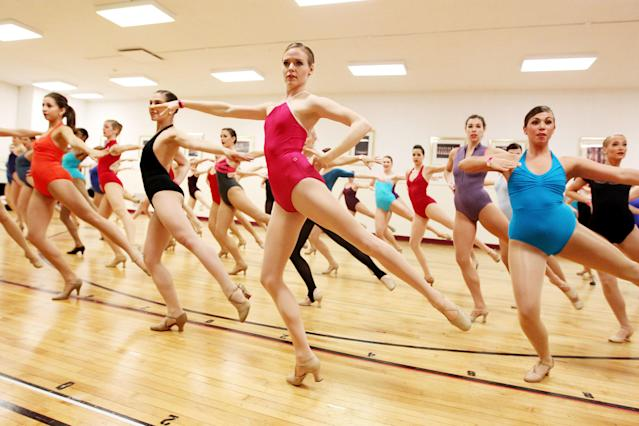 This image released by Starpix shows Liz Daniels, of San Diego, center, auditioning with other aspiring dancers for a spot with the Rockettes, Tuesday, April 30, 2013 at Radio City Music Hall in New York. Hundreds of young women from around the country are vying to appear with The Rockettes at the 2013 Radio City Christmas Spectacular. The aspiring dancers lined up Tuesday outside Radio City Music Hall for the open audition. Those who make it will return for the show that runs from Nov. 8 to Dec. 30. (AP Photo/Starpix, Amanda Schwab)